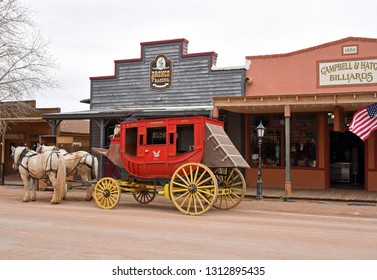 Tombstone, Arizona/USA - February 9, 2019: Historic red and yellow horse carriage on main street