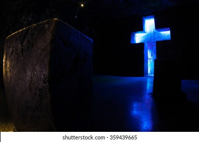 Tombstone and cross with blue light in salt cathedral Zipaquira