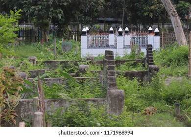 Tombstone and graves in an ancient Muslim graveyard.Set of Tombstones are made from stone and looking very old.graves with grave stones at a cemetery.