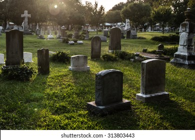 Tombstones in cemetery at dusk
