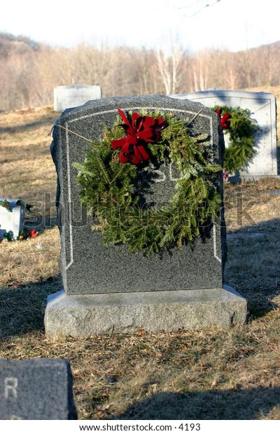 tombstones decorated for the holidays