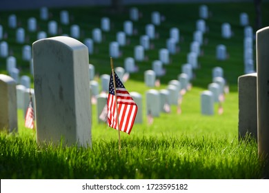 Tombstones and United States Natioanal flags during Memorial Day - Circa Washington DC USA