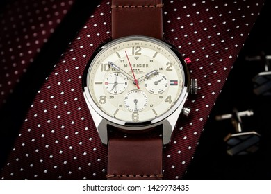 Tommy Hilfiger watch lying on a tie, expensive, luxury