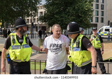 A Tommy Robinson supporter is arrested during the Free Tommy Robinson protest in Cambridge, United Kingdom, 21/07/18.