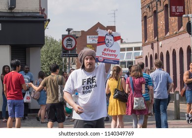 A Tommy Robinson supporter holds a sign during the Free Tommy Robinson protest in Cambridge, United Kingdom, 21/07/18.