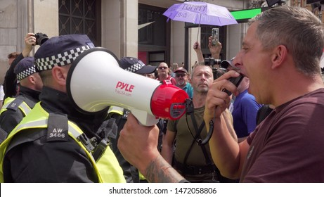A Tommy Robinson supporter shouts at police along Oxford Street in London, UK, 03/08/19