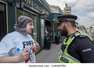 A Tommy Robinson supporter speaks with the police during the Free Tommy Robinson protest in Cambridge, United Kingdom, 21/07/18.