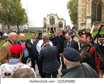Tommy Robinson visits a war memorial in London and is asked to tell journalists and photographers to leave the area, UK, 11/06/18