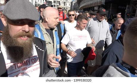 Tommy Robinson walks with a crowd of supporters as he leaves the trial at the Old Bailey, London, UK 05/14/19
