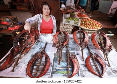 Tomohon, North Sulawesi / Indonesia - March 23, 2012 : Ikan Cakalang Asap or smoked skipjack traders in Tomohon traditional market