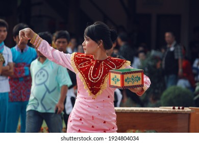 Tompaso, Indonesia - July 7, 2011: A Kabela Dancer performance. The Kabela Dance is a traditional dance from the Bolaang Mongondow tribe, North Sulawesi province.