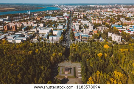 Tomsk cityscape and Tom river from aerial view. Modern urban landscape. Autumn season