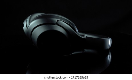 TOMSK, RUSSIA - April 12, 2020: Sony WH-1000XM3 Noise Canceling Wireless Headphones on a rotation platform black background. lies