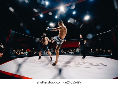 TOMSK, RUSSIA - February 12, 2017: GRAND PRIX  Power Club on MMA. Varos Tadevosyan VS Kerimbayev Altnybek. Boxers fighters  fight in fights without rules in the ring octagon.Toning