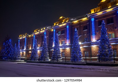 TOMSK, RUSSIA - JANUARY 05, 2019:  Administrative building, the former provincial classical male gymnasium dressed up Christmas lights