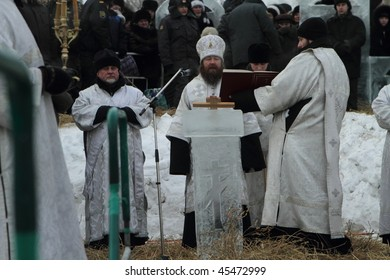 TOMSK, RUSSIA - JANUARY 19: Consecration ice-hole (Rostislav - Archbishop of Tomsk and Asino), celebration of Epiphany (Holy Baptism) in the Orthodox tradition, January 19, 2010 in Tomsk, Russia.