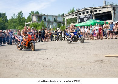 """TOMSK, RUSSIA - JULY 17:  The Bike-show """" The Steel wind"""" on July, 17 2010 in Tomsk, Russia. Motorcyclists compete among themselves on the baizes."""