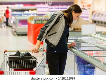 TOMSK, RUSSIA - June 19, 2019: Woman customer in food supermarket