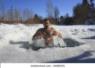 TOMSK, RUSSIA - MARCH 7: Traditional Siberian winter recreation - swimming in the ice-hole, March 7, 2009 in Tomsk, Russia.