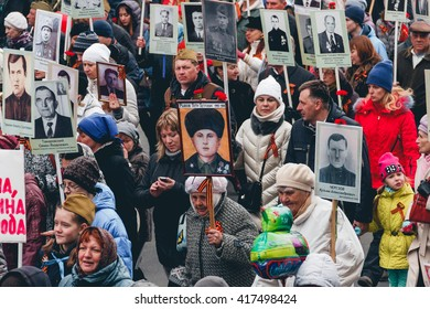 TOMSK, RUSSIA - MAY 9, 2016:  Procession of people in Immortal Regiment on Victory Day, May, 9, 2016 in Tomsk, Russia