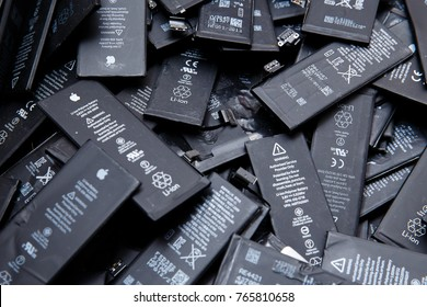 TOMSK, RUSSIA - November 29, 2017: Used batteries of mobile phones iPhone, preparation for recycling and disposal in the service