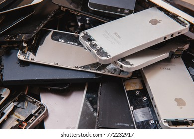 TOMSK, RUSSIA - November 29, 2017: broken panels and screens of iPhone phones lie in the service and are preparing for recycling and disposal