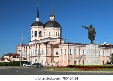Tomsk, Russia -  September 2016: Epiphany Cathedral and statue of Lenin