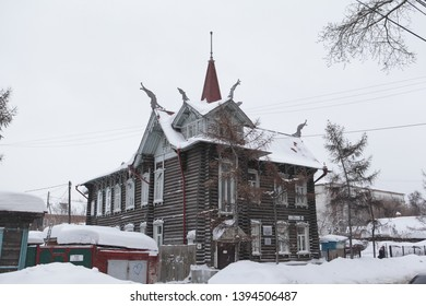 """TOMSK, RUSSIAN FEDERATION - DECEMBER 30, 2016: Old wooden house (""""House with dragons"""") with carved windows in Krasnoarmeyskaya Street, 68, Tomsk city (Russia). Russian style in architecture"""
