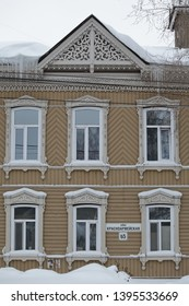 TOMSK, RUSSIAN FEDERATION - DECEMBER 30, 2016: Old wooden house with carved windows in Krasnoarmeyskaya Street, 65, Tomsk city (Russia). Russian style in architecture and snowy winter