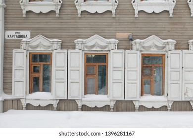 TOMSK, RUSSIAN FEDERATION - DECEMBER 30, 2016: Carved windows on old wooden house in Kartashov Street, 32a, Tomsk city (Russia). Russian style in architecture