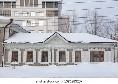 TOMSK, RUSSIAN FEDERATION - DECEMBER 30, 2016: Old wooden house with carved windows in Kartashov Street, 32b, Tomsk city (Russia). Russian style in architecture and snowy winter