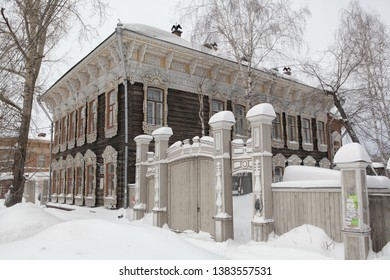 TOMSK, RUSSIAN FEDERATION - JANUARY 2, 2017: Old wooden house with carved windows in Shishkov Street, 14, Tomsk. Russian style in architecture