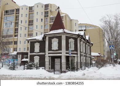 TOMSK, RUSSIAN FEDERATION - JANUARY 3, 2017: Old wooden house with carved windows and balcony in Krasnoarmeyskaya Street, 12a, Tomsk city (Russia). Russian style in architecture