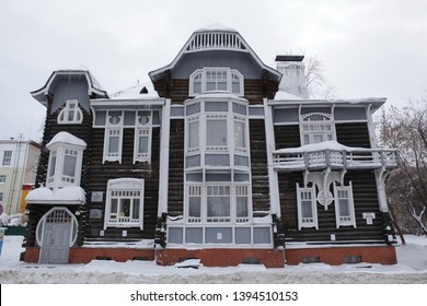 TOMSK, RUSSIAN FEDERATION - JANUARY 5, 2017: Old wooden house in Kirov Avenue, 7, Tomsk city (Russia). Former mansion of civil engineer A.D. Kryachkov, now - Tomsk museum of wooden architecture