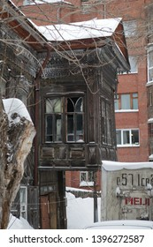 TOMSK, RUSSIAN FEDERATION - JANUARY 5, 2017: Old wooden house with carved windows and balcony in Voykov Street, 23, Tomsk city (Russia). Russian style in architecture