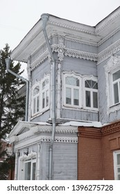 TOMSK, RUSSIAN FEDERATION - JANUARY 5, 2017: Grey old wooden house with carved windows in Sukhoozerny Lane, 13, Tomsk city (Russia). Russian style in architecture