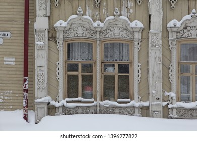 TOMSK, RUSSIAN FEDERATION - JANUARY 5, 2017: Carved windows on old wooden house in Lenin Avenue, 8, Tomsk city (Russia). Russian style in architecture