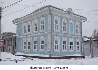 TOMSK, RUSSIAN FEDERATION - JANUARY 5, 2017: Blue old wooden house with carved windows in Voykov Street, 19, Tomsk city (Russia). Russian style in architecture