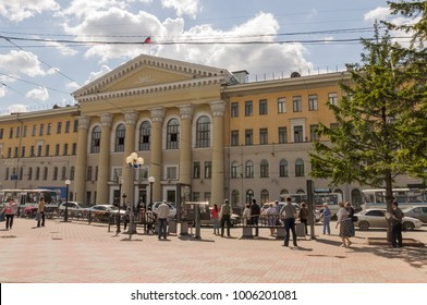 Tomsk, Russia,The Tomsk University of Control Systems and Radioelectronics in summer day. July 10, 2017. Lot of peoples around. Big fountain