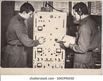TOMSK, USSR - CIRCA 1970: Two young soldiers serving combat post in Soviet Signal Corps. Army, radio, electronics, Siberia, military, headphones, signal, encryption, vintage, retro, working, office