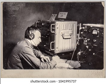 TOMSK, USSR - CIRCA 1970: Young soldier serving combat post in Soviet Signal Corps. Caption: Battle Station No. 72. Combat Communication. Army, radio, electronics, Siberia, military, headphones, north