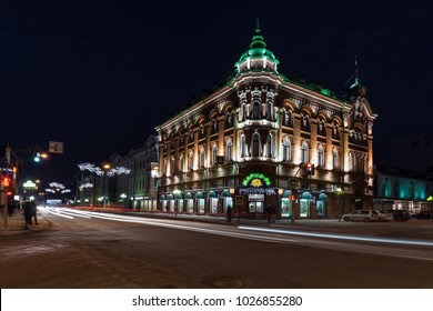 TOMSK/RUSSIA - FEBRUARY 10, 2018. An old building in the central street of Tomsk on a winter night