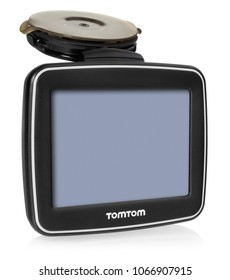 TomTom GPS car navigation with handle. Black electronic map device with blue screen and silver border. Satellite navigation device on white background.