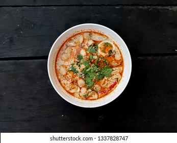 Tomyam kung, Tomyum kung, Thai food on black wood background, bird view