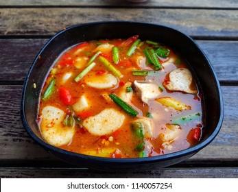 tomyam thai food on wooden table