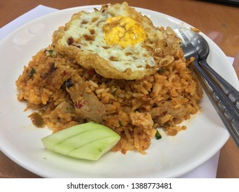 Tomyum fried rice with egg , Thai food .