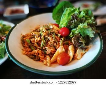 Tomyum fusilli serve with fresh organic vegetable.
