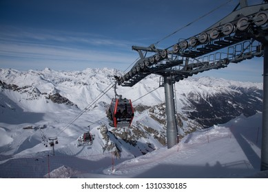 Tonale Pass, Italy - February 09, 2019: View of the mountains around the Tonale Pass and its cableway during a winter sunny day. Tonale is a mountain pass between Lombardy and Trentino