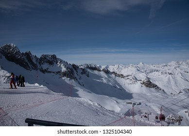 Tonale Pass, Italy - February 09, 2019: People skiing on the mountains around the Tonale Pass and the Presena glacier during a winter sunny day. Tonale is a mountain pass between Lombardy and Trentino