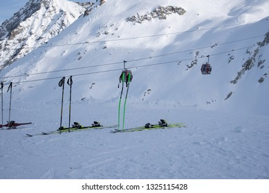 Tonale Pass, Italy - February 09, 2019: A set of skiing equipment on the Presena glacier, near the Tonale Pass, during a winter sunny day. Tonale is a mountain pass between Lombardy and Trentino